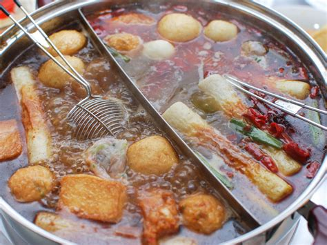 pot cuisine style pot with rich broth shrimp balls and