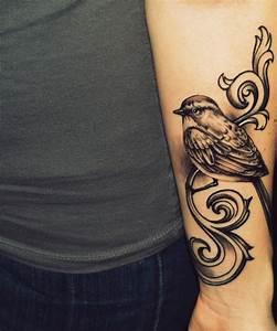 Fantastic Bird Tattoo On Lower Arm | Tattooshunt.com