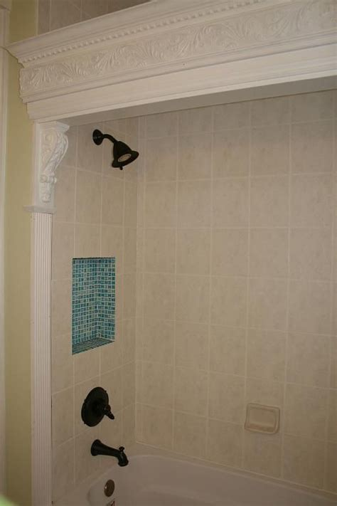 reclaimed wood cornices and tile detail in our bathroom