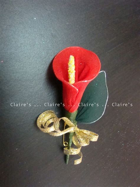 red gold wedding flowers family buttonholes red