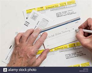 Man writing check to Internal revenue service IRS form ...