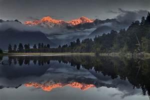 Sunset Reflection Of Lake Matheson Photograph by Colin