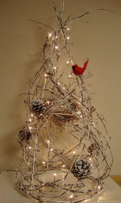 twig christmas tree with lights and cardinal christmas