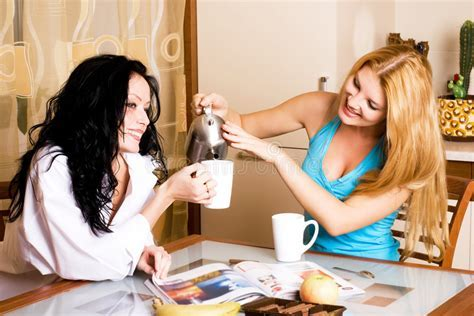 Two Girls Having Tea And Gossiping Stock Image   Image