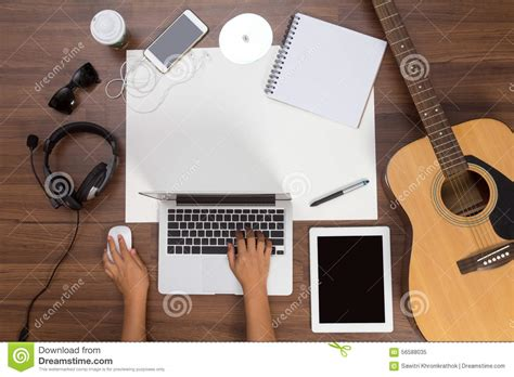 Office Desk Background Hand Using A Laptop Acoustic Guitar