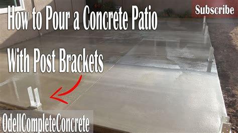 pour  concrete patio  post brackets  fences