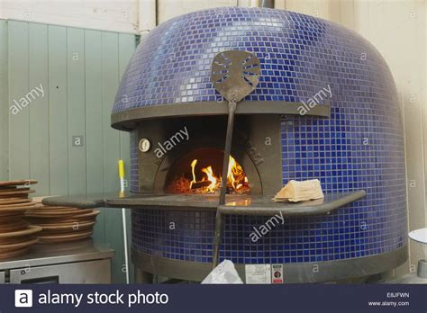 lighting a traditional italian wood fired pizza oven in