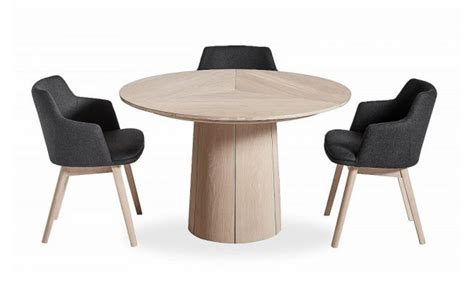 One can get creative with his interior furnishings by for one, a small coffee table can provide an outlet for one to place his coffee mug as one enjoys some rest in the morning before heading to work in singapore. SM32 Round Extendable Dining Table - Danish Design Co