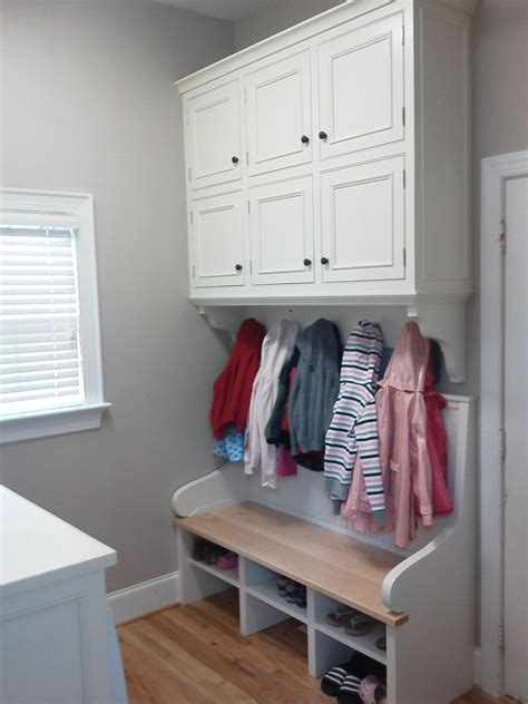 cabinet makers warehouse stuart hand made built in laundry room cabinets and bench by