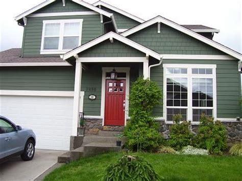 green siding door home exterior
