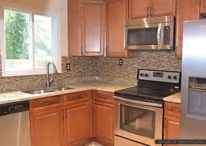 backsplash ideas for white kitchen brown glass tile santa cecilia countertop