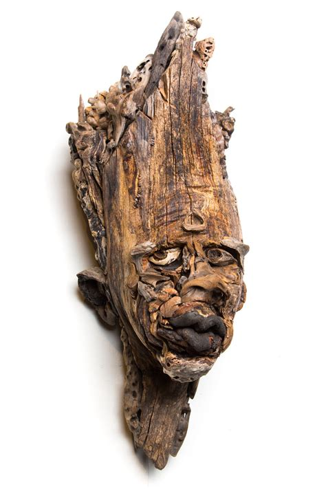 sculpting faces  bodies  driftwood