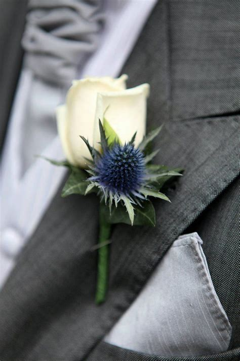 navy  white boutonniere    white rose