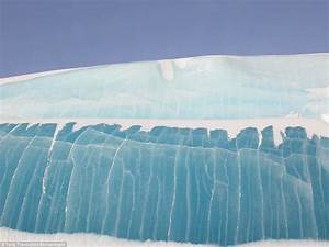 'Frozen waves' of blue ice photographed by Tony ...