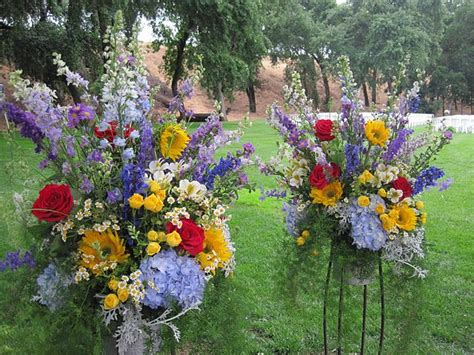 large floral arrangements  ceremony  iron stands