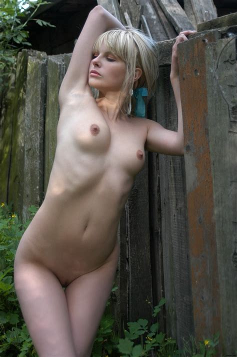 A Young Blonde Showing Her Naked Body In The Village