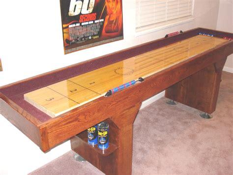 a shuffleboard table here s how to play blocking shuffleboard 7337