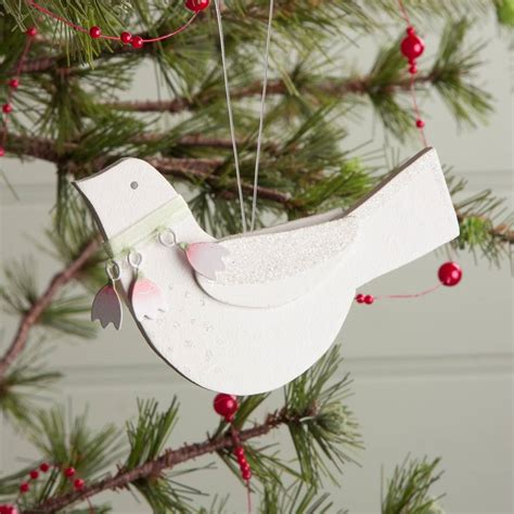 white wooden dove decoration by the christmas home