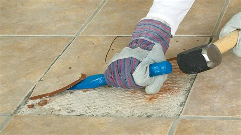 replacing a broken or cracked wall or floor tile how to remove wall tiles removing floor