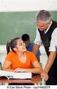 Picture of mature high school teacher talking to student ...