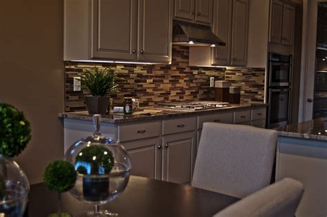 how to install led strip lights under cabinets how to choose between led strip lights and led puck lights