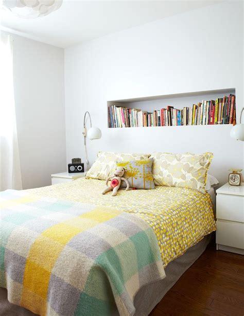 bedroom white walls built  shelf  bed  books