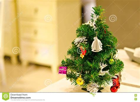 Small Decorated Christmas Tree On Table Stock Image