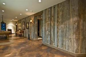 Barnwood walls and stained concrete floor cool for a