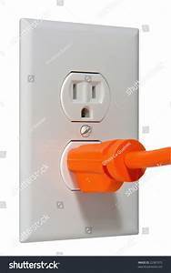 North American Standard 110 Volt Electric Wall Outlet Receptacle With Plug Inserted Stock Photo