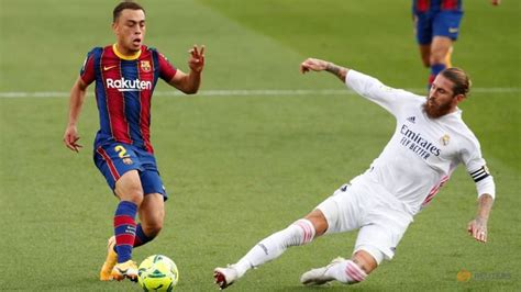 Football: Real Madrid sink Barca in 'Clasico' with help of ...