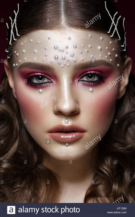 Beautiful Girl With Perfect Art Makeup And Pearl Beads