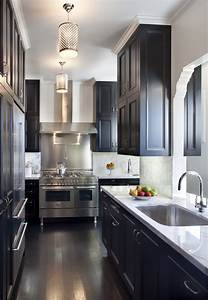 One color fits most black kitchen cabinets for Kitchen cabinet trends 2018 combined with navy blue and white wall art