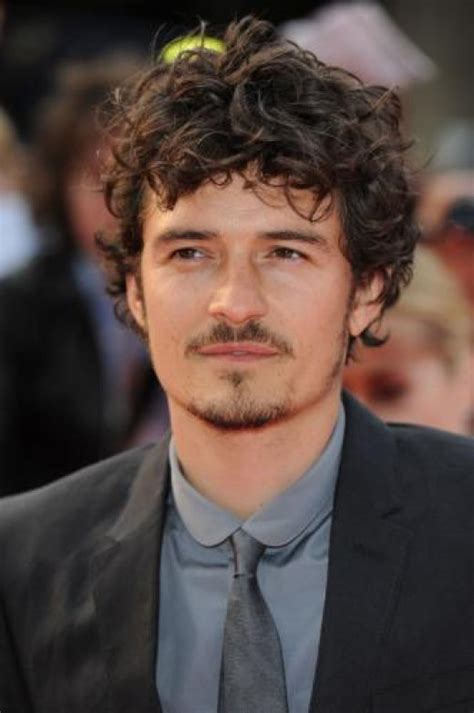 orlando bloom 36 has a long curly hair very playful and
