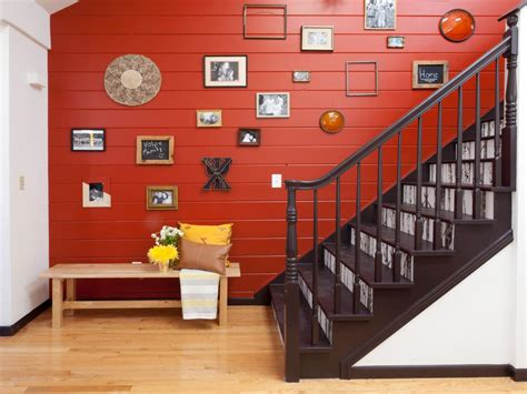 red paneled stairwell  photo gallery wall hgtv