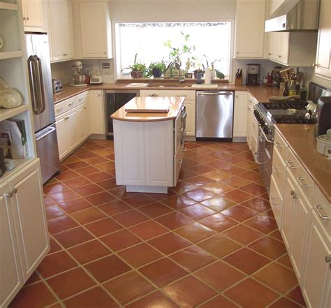 white kitchen cabinets with tile floor kitchen with mexican tile installed on a diagonal and 2088