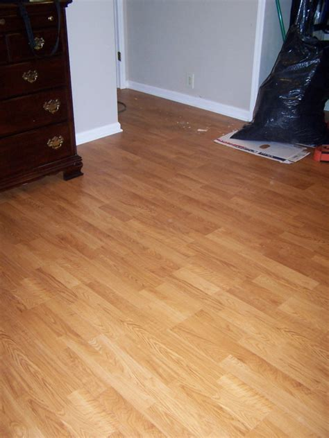 laminate wood flooring rising what type of flooring is best for rentals