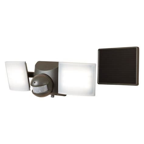 2 head led motion activated flood light shop all pro 180 degree 2 head bronze led motion activated