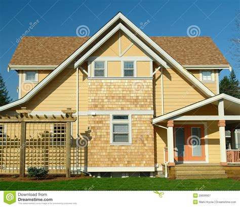 New Home Exterior Yellow Siding Royalty Free Stock