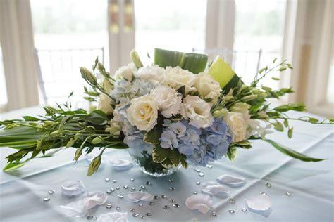 white rose  baby blue hydrangea centerpiece