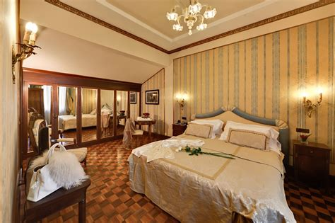 The Classic Rooms Of Due Torri Hotel Are Furnished With