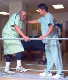 Therapist helps with gait training. physical therapists work with ... Physical Therapy