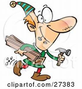 Friendly Male Handyman In Green, Hammering A Nail Into A ...