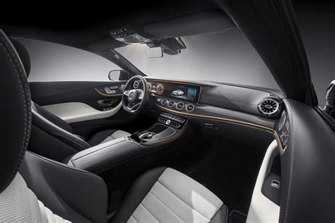 The coupe pictured here shares the front half of the sedan's interior, save for finned air vents and aggressively bolstered sport seats. 2018 Mercedes-Benz E-Class Coupe: Review, Trims, Specs, Price, New Interior Features, Exterior ...
