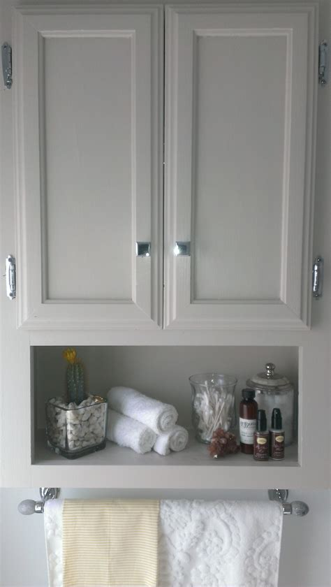 bathroom above toilet cabinet for easy access