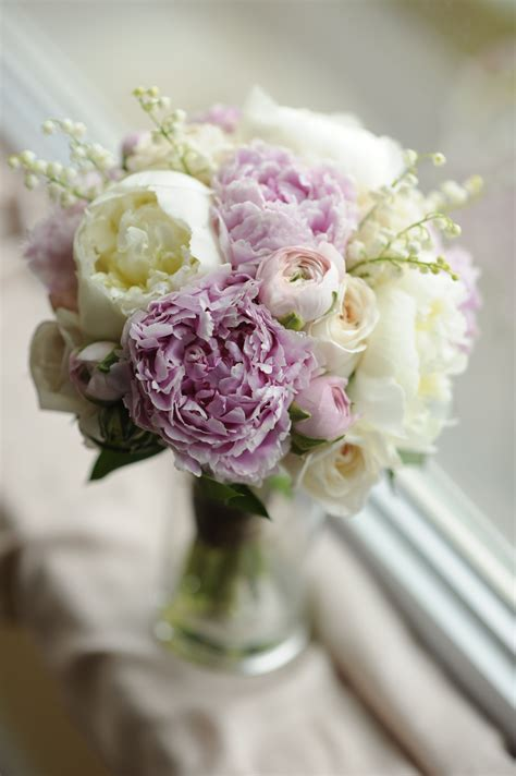 my wedding bouquet of peonies lily of the valley roses