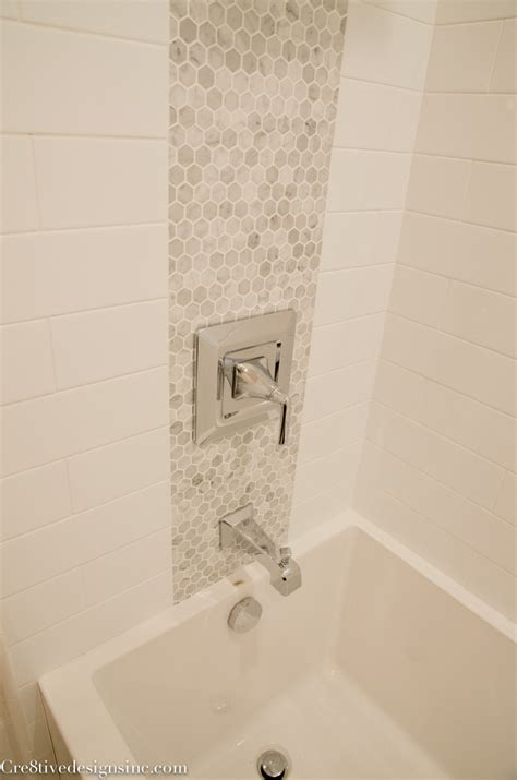 accent tile in shower using accent tiles to tie the plumbing fixtures together is a neat idea keeps it from looking