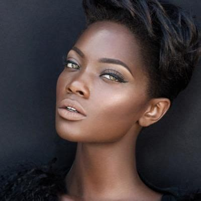 beautiful woman  high cheekbones brown skin  short