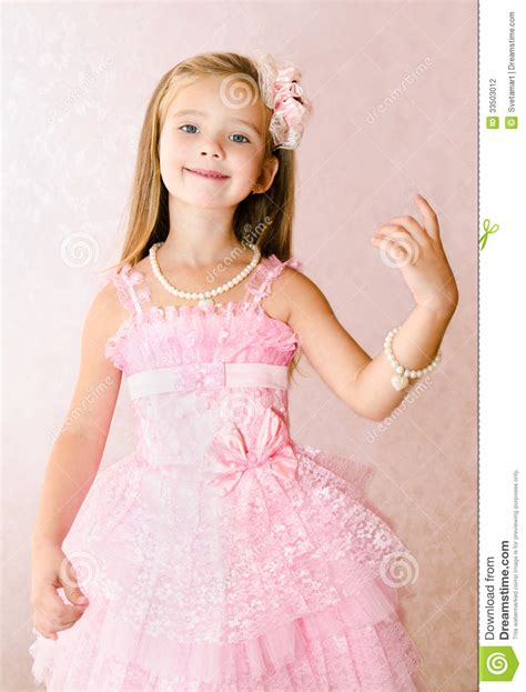 Portrait Of Smiling Little Girl In Princess Dress With A