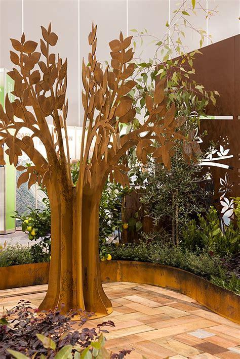pin  garden sculptures  entanglements metal art