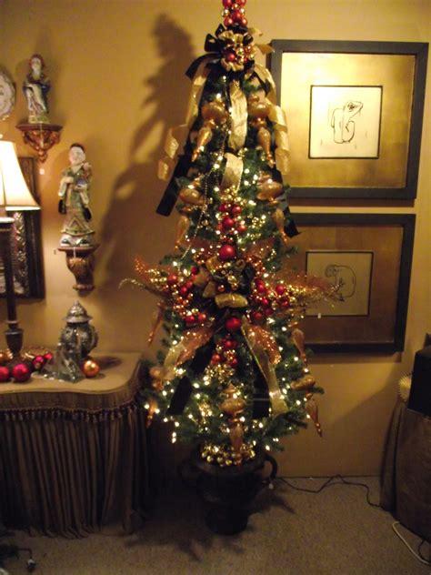decorating  christmas tree  black  goldcopper